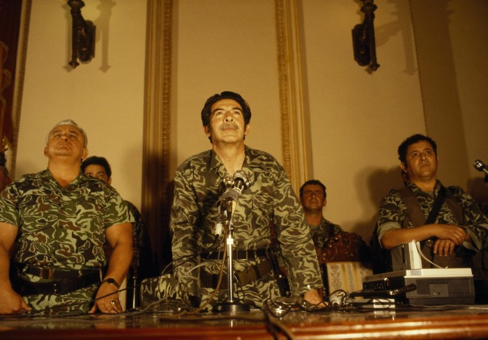 Gen. José Efraín Ríos Montt (center) at first press conference after seizing power in military coup. 23 March 1982, National Palace, Guatemala City, Guatemala. Photo courtesy of Jean-Marie Simon.