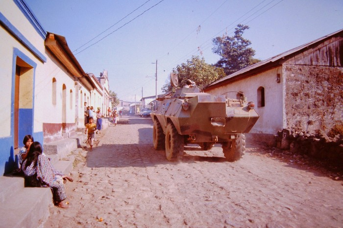 Army tank drives down street in Santiago Atitlán, 1987.