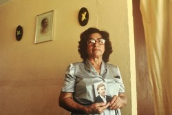 Ester Herrarte stands in the living room where her son Jorge, in the photograph, was abducted in 1983.